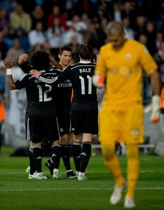 Cristiano Ronaldo (3dR) of Real Madrid CF celebrates scoring their fourth goal with teammates Marcelo (L), Daniel Carvajal (2ndL) and Gareth Bale (2ndR) as goalkeeper Ruben Martinez of Almeria UD reacts defeated during the La Liga match between UD Almeria and Real Madrid CF at Juegos del Mediterraneo stadium on December 12, 2014 in Almeria, Spain.