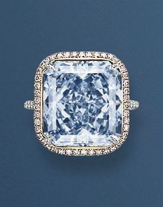 AN EXTRAORDINARY COLOURED DIAMOND RING Set with a rectangular-cut fancy intense blue diamond weighing 13.39 carats, to the micro pavé-set fancy pink diamond surround and diamond bifurcated hoop, mounted in platinum and 18k white gold, ring size 6