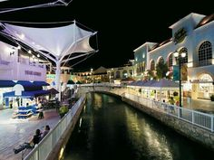 La Isla Shopping Center, Cancun with a lagoon, dolphin aquarium, and water front restaurants...cool.