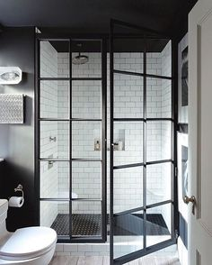 Black is back in a BIG way. This sophisticated little setup by @jennywolfinteriors is the #LBD of bathrooms -- effortlessly chic. #bathroom #interiordesign #dreamhome #interiorinspo #smallspaces #subwaytile #black #shower #tile #trend