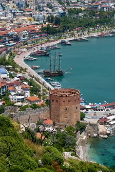 Harbour view, Alanya, Turkey - photo by Darrell Godliman. The Red Tower (Kızıl Kule) is a well-known building in Alanya. The 108-foot (33-m) high brick building contains the municipal ethnographic museum. Sultan Kayqubad I brought the accomplished architect Ebu Ali from Syria to Alanya to design the building. The last of Alanya Castle's 83 towers, the octagonal structure specifically protected the Tersane, a medieval drydock built by the Seljuk Turks in 1221