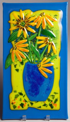 Fused glass wall art panel - black-eyed Susan (sunflower) floral I cut sheet glass into pieces to create flower petals and leaves. I stack