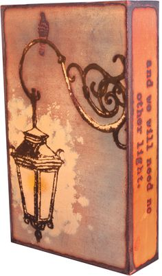 """143 """"Illumine"""" 2013 Spiritile by Houston Llew. """"Inner light will shine forth from us, and we will need no other light."""" - Goethe. Inspirational quote with vintage street lantern design. Every Spiritile is made in America from copper, glass and wood. It hang on a wall or stand alone, will never fade or tarnish and seems to shimmer in the light. $115"""