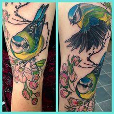 https://i.pinimg.com/736x/c8/ab/2c/c8ab2c75acf0c7f11f0e81ba99c98aff--bird-flower-tattoos.jpg