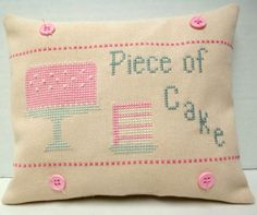 Because it's just too cute:  Piece Of Cake Cross Stitched Mini Pillow by luvinstitchin4u, $17.99