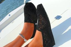 I think it's a official.  I now want a pair of toms but just these ones.