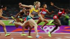 Sally Pearson of Australia crosses the line to win gold in the Women's 100m Hurdles Final
