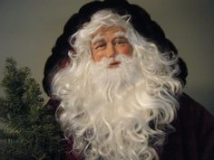 "Karen Vander Logt is a master at making her sculpted Santa faces come to life. ""Father Christmas"" is approx. 6'2"" tall and a OOAK Collectible Santa. His head is hand-sculpted, using super sculpey clay and he has beautiful blue, blown glass eyes. Karen was honored to have had this Santa chosen by EARLY AMERICAN LIFE magazine in 2010."