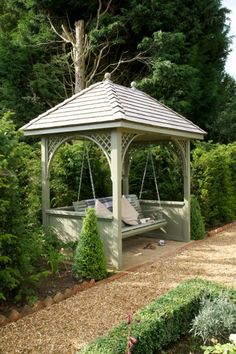 Bespoke arbour with swing from The Garden Trellis Company...