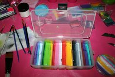 Bead containers with a cute case, 18 compartments in total. My brushes fit inside the case. I love, love, love the long stroke and my #12 brush fits just right.