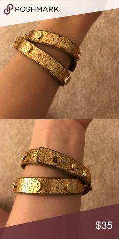 TORY BURCH cuff bracelet- limited edition!!! Gold Tory Burch cuff bracelet with gold emblems Jewelry Bracelets