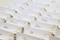 White Wedding place cards with pearl glass bead and feather handcuted of paper decor on Etsy, $3.05 AUD
