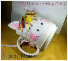 Rainbow Unicorn DIY tutorial mug. Just another Lenny the Unicorn inspired DIY from . This cute hand sewn felt cosy makes a lovely gift or just a charming additon to a hot cup of cocoa. I used white and yellow felt, scraps of Cross Stitch Thread, Fabric Glue, Rainbow Unicorn, Diy Tutorial, Cosy, Hand Sewing, Fairy Tales, Scrap, Snoopy