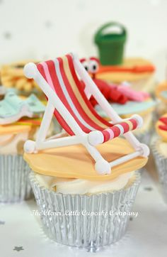 Silver wrapper for simple vanilla cupcake makes it more interesting. The tiny chair decoration is just fantastic.