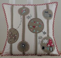 Adorable pillow - you could do this in so many different ways...I love the polk-a-dot binding.