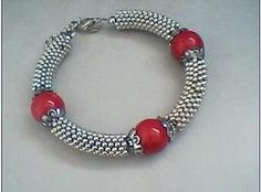 Tibetan tribal Three beaded bracelet comes in red,blue and green get yours at www.godisjewelz.com $5