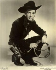 LASH LaRUE born Alfred LaRue on June 15, 1921 and died on May 21, 1996. Naturally, he got his name from his use of a bullwhip to disarm the villains. He started out as the Cheyenne Kid, but was so popular with his whip that he was given his own films. He was later copied by Whip Wilson.
