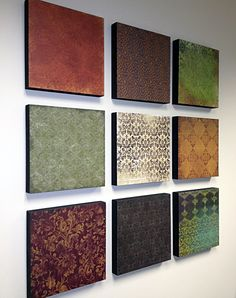 Scrapbook Paper Wall Art - this was a fun simple DIY. Just 12x12 scrapbook papers Mod Podged on 12x12 boards. This is hanging on my office wall at work. The fun part is choosing the papers to mix n' match!