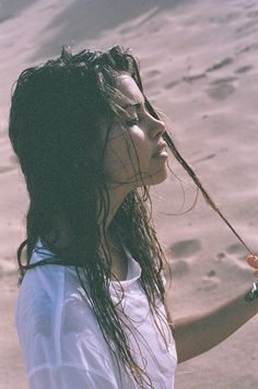"The sand covered her, sticking to her wet body. Her hair was soaked and she quickly rung it out. ""This is just as crazy as my family."""