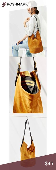 NWT🍂UO Drapey Suede Hobo Bag by BDG Camel/Brown Brand new with tags perfect for fall! No defects smoke free pet friendly - absolutely stunning. Color is a bit more brown than yellow. See last photo for more accurate hue.  ↗️PRICE FIRM UNLESS BUNDLED⬅️⬅️ Urban Outfitters Bags Hobos