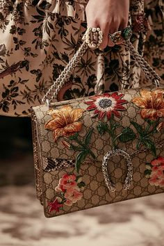 Embroidered and embellished with handmade patches, the new Gucci Dionysus shoulder bag from the Gucci Spring Summer 2016 collection, by Alessandro Michele.