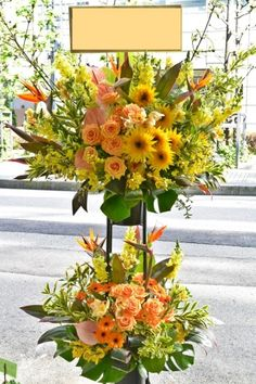flower stand sunflower with orange roses gluckfloristik.com