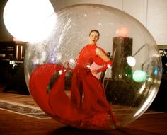 Dancer in the bubble, walking ball, walking sphere, red theme event, Novelty Entertainment Las Vegas, for booking or questions info@noveltyent.com