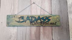 A Badass with a good asssign handpainted on reclaimed wood,  measures approx 30cm  I use various paints and stains to create unique effects on my signs so each is truly individual.  Please note as all of my upcycled pieces are made from reclaimed and vintage items you may see signs of wear and tear this does not affect the integrity of the piece and all adds to the charm of a bespoke upcycled piece of home decor, | Shop this product here: http://spreesy.com/forestfurnishings/106 | Shop all…
