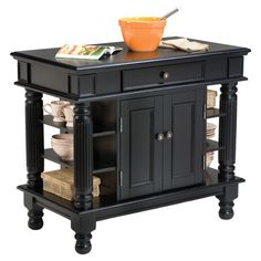 Perfect for preparing farm-fresh family meals and stowing cookware and dry goods, this timeless ebony-finished kitchen island showcases fluted legs and 6 ope...