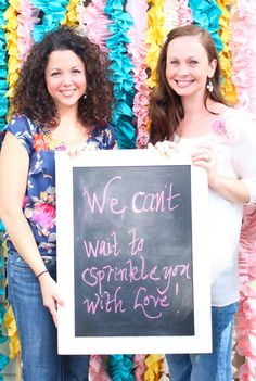 Baby Shower: message to the baby. :) Cute idea! Have guests/family write messages to the soon-to-be new member of the family and take a picture of the guests holding it! <3