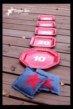 Halloween Carnival Booth Ideas | Bean Bag Toss - Party Plates #chinet #party #blockparty