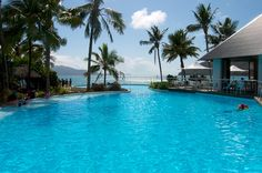 Imagine a refreshing dip in this crystal clear swimming pool at Hamilton island Resort Centre, Whitsundays.