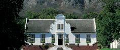 Bustling with vineyards, heritage architecture, art and plenty of opportunities for outdoor dining, Angela Lloyd shares her Stellenbosch travel guide. South Afrika, Cape Dutch, African House, Dutch House, Cape Town South Africa, Thatched Roof, Once In A Lifetime, Adventure Is Out There, Beautiful Gardens