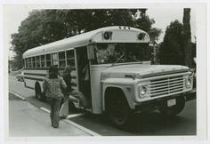 Students boarding Five College Bus on College Street :: Archives & Special Collections Digital Images :: circa 1970-1979
