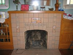 The Batchelder tile fireplace and built-ins, during the wall repainting