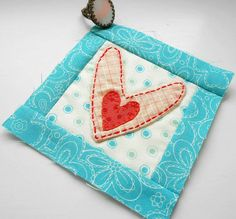 A cheat on the fiddly turned applique method.  The little polka dot heart was hand stitched in place before the heart was sewn together. find out more about the Cheating Heart block at the Patchsmith.