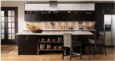 Distinctly Walker Zanger, the backsplash here is from World Mosaic, designs by Janine Love. As seen on an Ikea ad.