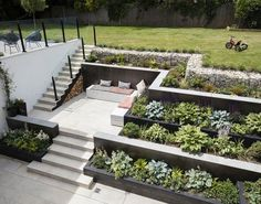 Grand Designs TV house from the 2018 series in Richmond, London with a sunken garden containing healthy p #basement Grand Designs TV house from the 2018 series in Richmond, London with a sunken garden containing healthy plants -tv-houses-granddesignsmagazine.com Sloped Backyard Landscaping, Landscaping Retaining Walls, Sloped Garden, Landscaping Ideas, Retaining Wall Gardens, Retaining Wall With Steps, Steep Hillside Landscaping, Retaining Wall Design, Terraced Backyard