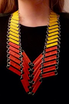 Make a vest, breastplate or collar out of paper clips. Then you can wrap each clip with colored duct tape. (Or not).