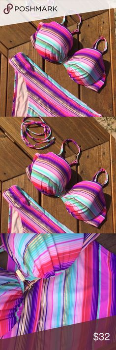 Victoria's Secret Multi-Way Striped Bikini Mix up your beach style with this multi-way bikini from Victoria's Secret. Go without straps, or take your pick of the neck tie or traditional bra-style straps (both sets included). The stripes are brightly colored, and the top offers comfortable cushion padding within. There are no pulls, no pilling, and no discoloration. Elasticity is in excellent condition. The only flaw is that the size tag on the bottoms has melted and shrunk so it isn't…