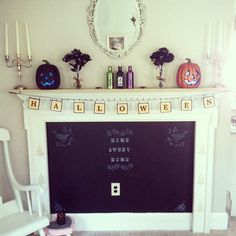 Pin for Later: 26 Real Halloween Decorating Ideas to Copy  What we love about this particular setup are the dark flowers — look for black dahlias, lilies, and tulips to create your own arrangement.