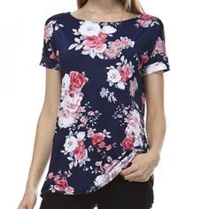 Navy Floral Knit Top! This navy blue floral top / tunic is so cute and comfortable! I nice smooth knit material. Perfect to keep you cool in the spring/summer! Short sleeves as well :) Tops Tunics