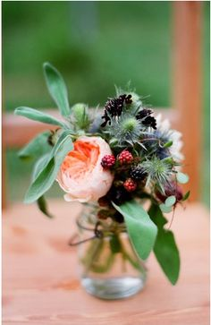 i like the dark berries with the peach rose to accent, but I'd add some dark purple foliage to this to keep it rich.