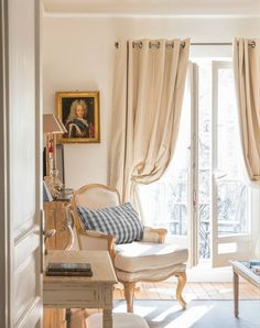 The warm, inviting French-style living room of the Calvados apartment rental | Paris Perfect