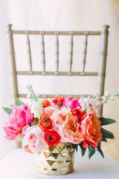 Pink, orange and gold floral arrangement