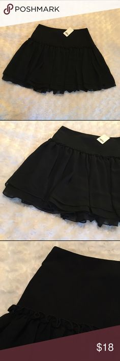 "Banana Republic Mini Skirt Banana Republic Black Mini Skirt. NWT. Side Waist Zip w/ Clasp. 16 1/2"" in length from Waist to Hem. Shell: 100% Polyester. Lining: 100% Acetate. 1️⃣ Banana Republic Skirts Mini"