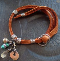Great design!  Indian Charm Looped Leather Bracelet by yuccabloom on Etsy (sold)