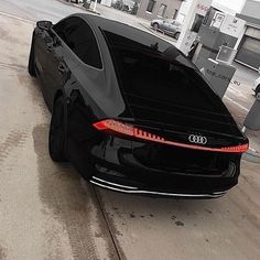 The all new Audi A7 pictured above in all black. Featuring a new taillight design spanning the width of the car below a retractable wing.…