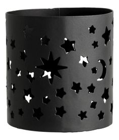 Black/Stars. Tealight holder in metal with a punched pattern. Height 7 cm, diameter 6.5 cm.