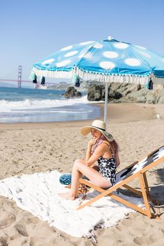 Upgrade your beach umbrella for summer with fringe and paint.